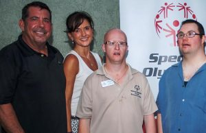 Craig and Debbie Danto with Special Olympians Larnie Killen and Blake Boris