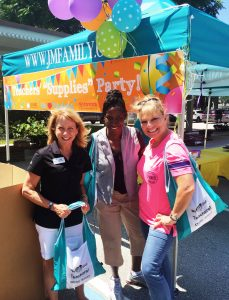 Kim Bentley (L) with teachers at JM Family's Teacher's Tote Supply Giveaway
